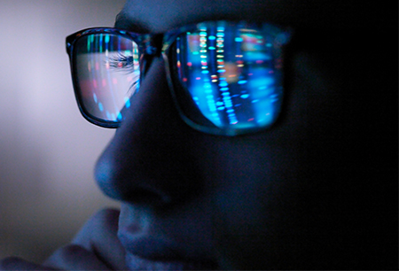 Person in glasses looking at data