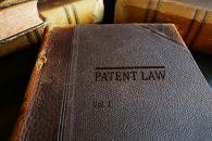 "Thick grey book stamped with ""Patent Law, Vol 1"""