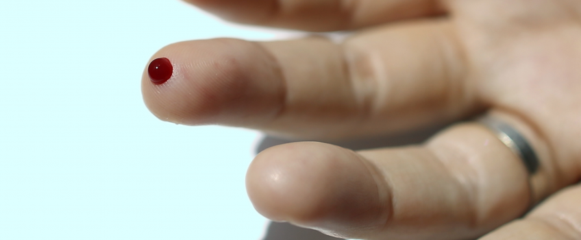 A finger with blood drop