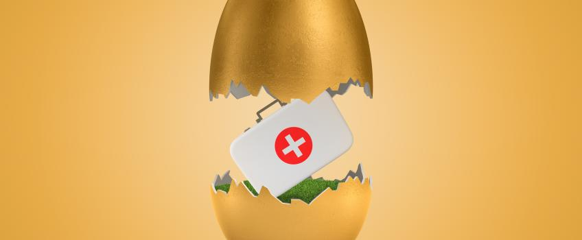A medicine box hatching out of a golden egg.