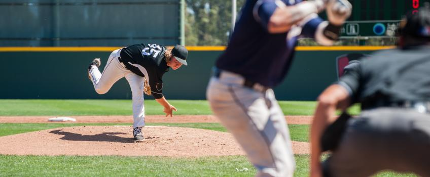 Baseball pitcher throwing a curveball.