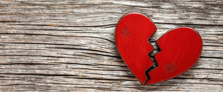 Broken heart against wooden background