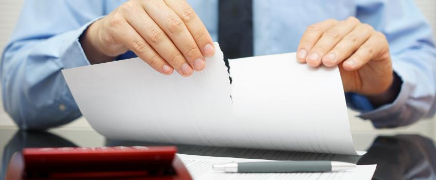 businessman tearing up a document