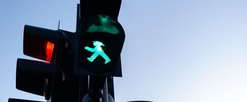 "A green light ""walk"" sign"
