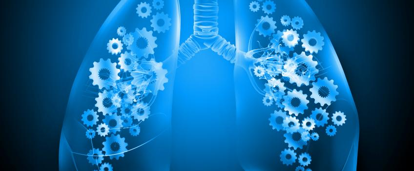 Blue lungs with cogs against dark background