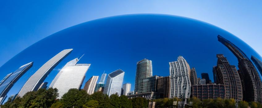 The Chicago skyline reflected in the Cloud Gate sculpture