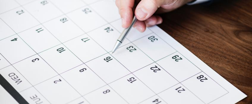 Person marking off an event on a calendar